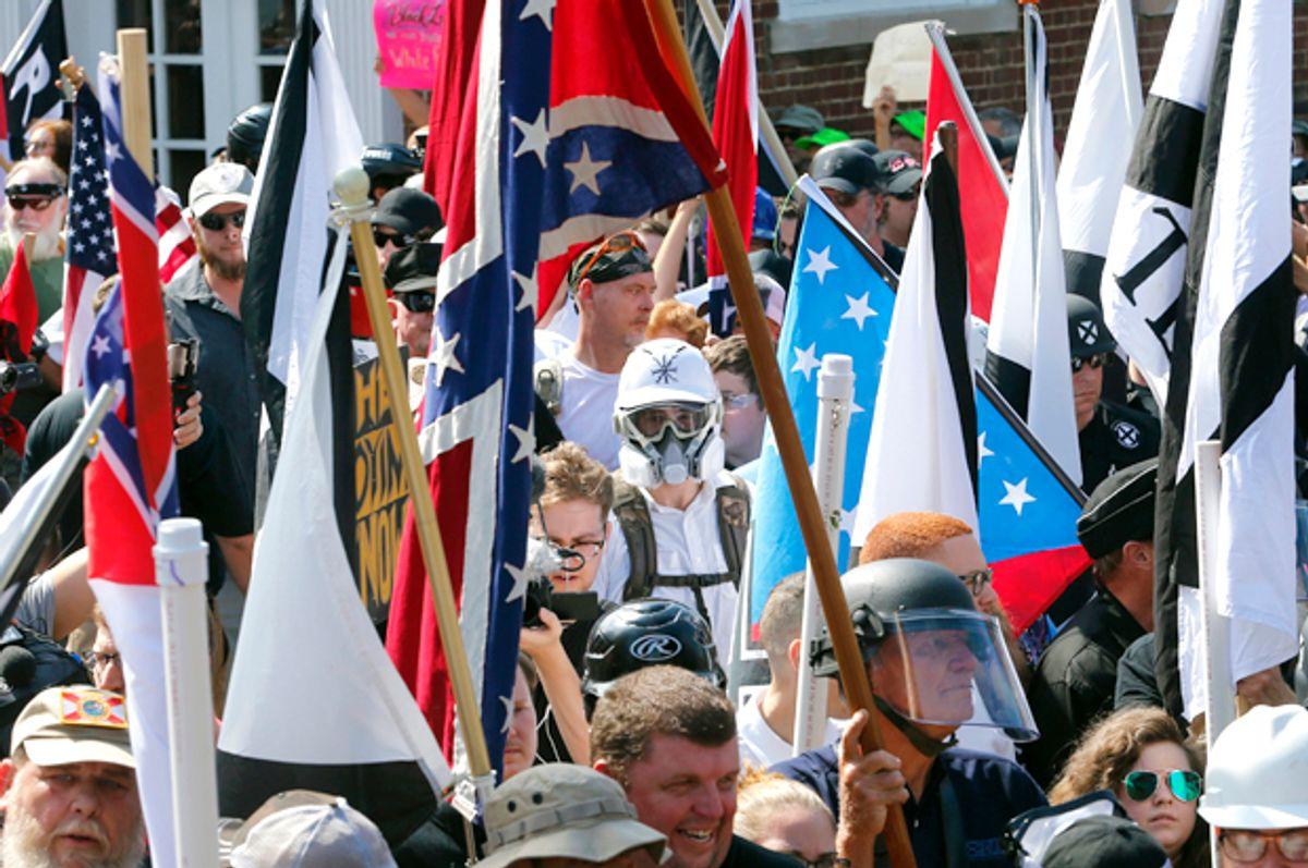 White nationalists walk into  Lee Park in Charlottesville, Va. (AP/Steve Helber)