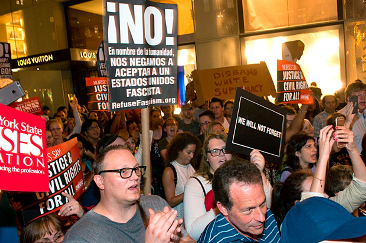Michael Moore leads his Broadway audience to Trump Tower to protest Donald Trump (Getty/Noam Galai)