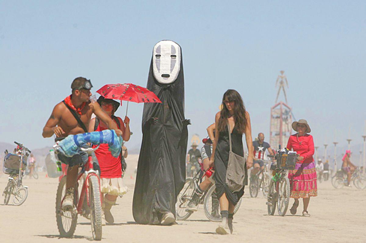 Burning Man participants walk on the playa at the Black Rock Desert (AP/Brad Horn)