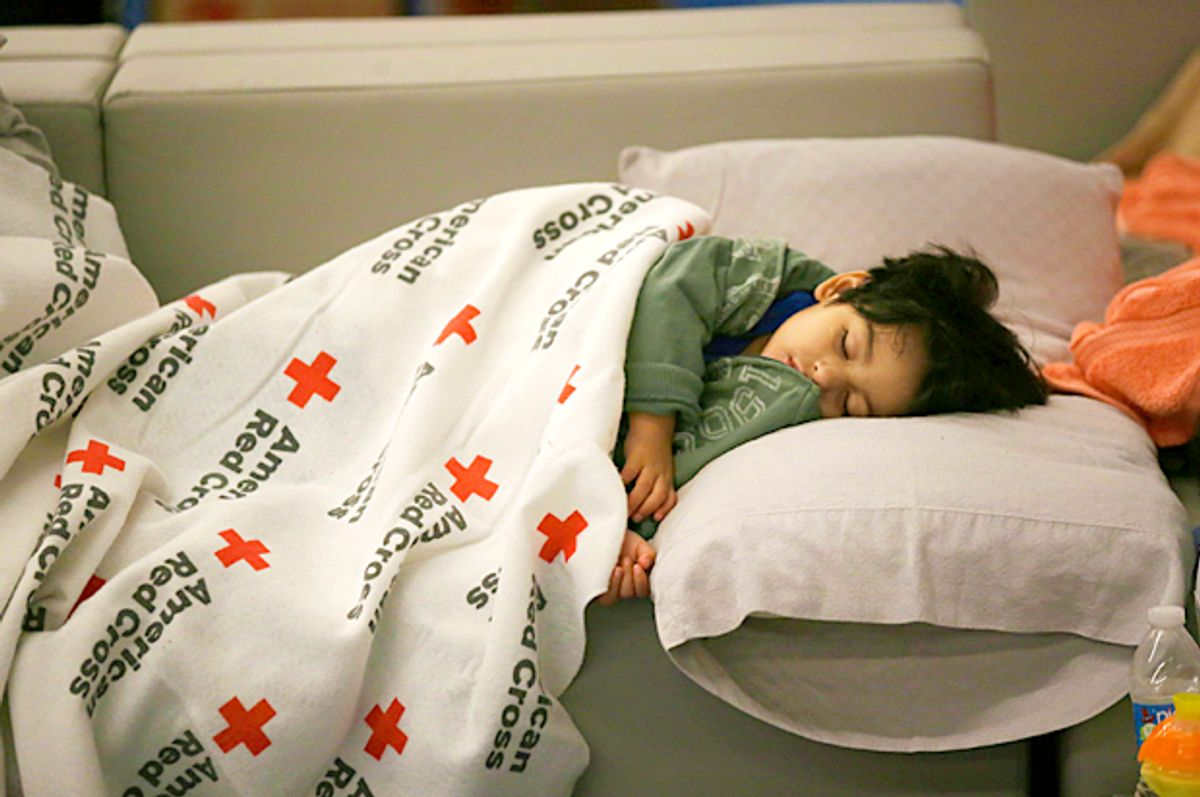 Malachia Medrano, 2, sleeps under a donated blanket at a shelter for Tropical Storm Harvey evacuees (AP/LM Otero)