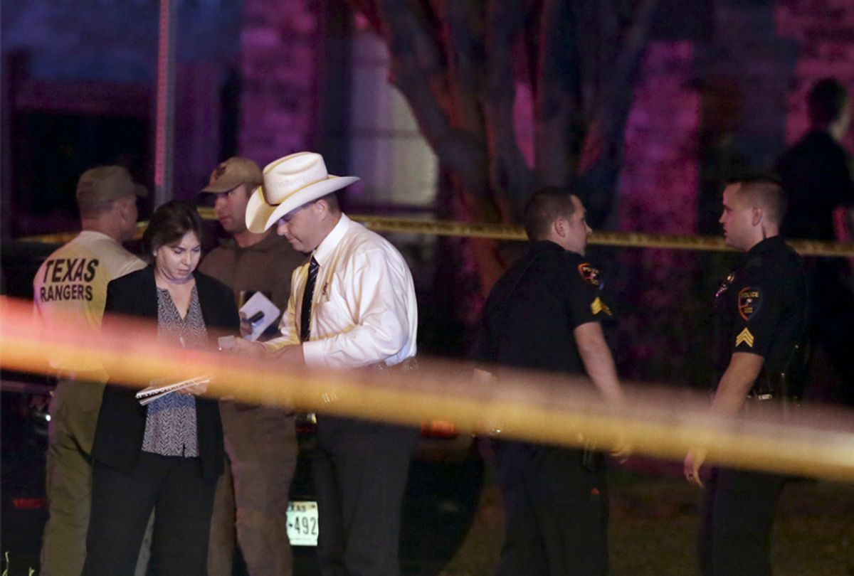 Law enforcement officers and investigators outside the scene of a shooting in Plano, Texas, Sept. 10, 2017.    (AP/LM Otero)