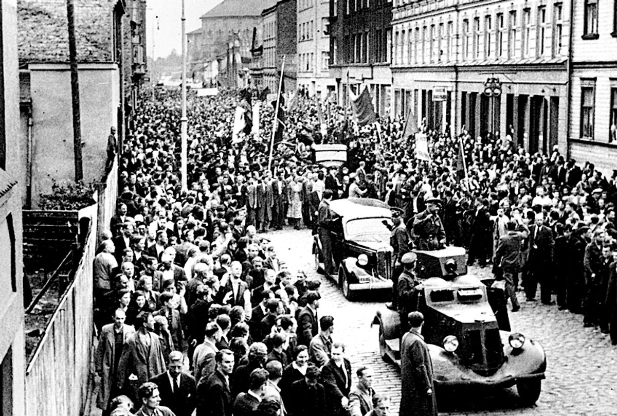 People line up to welcome the Soviet Red Army  (Associated Press)