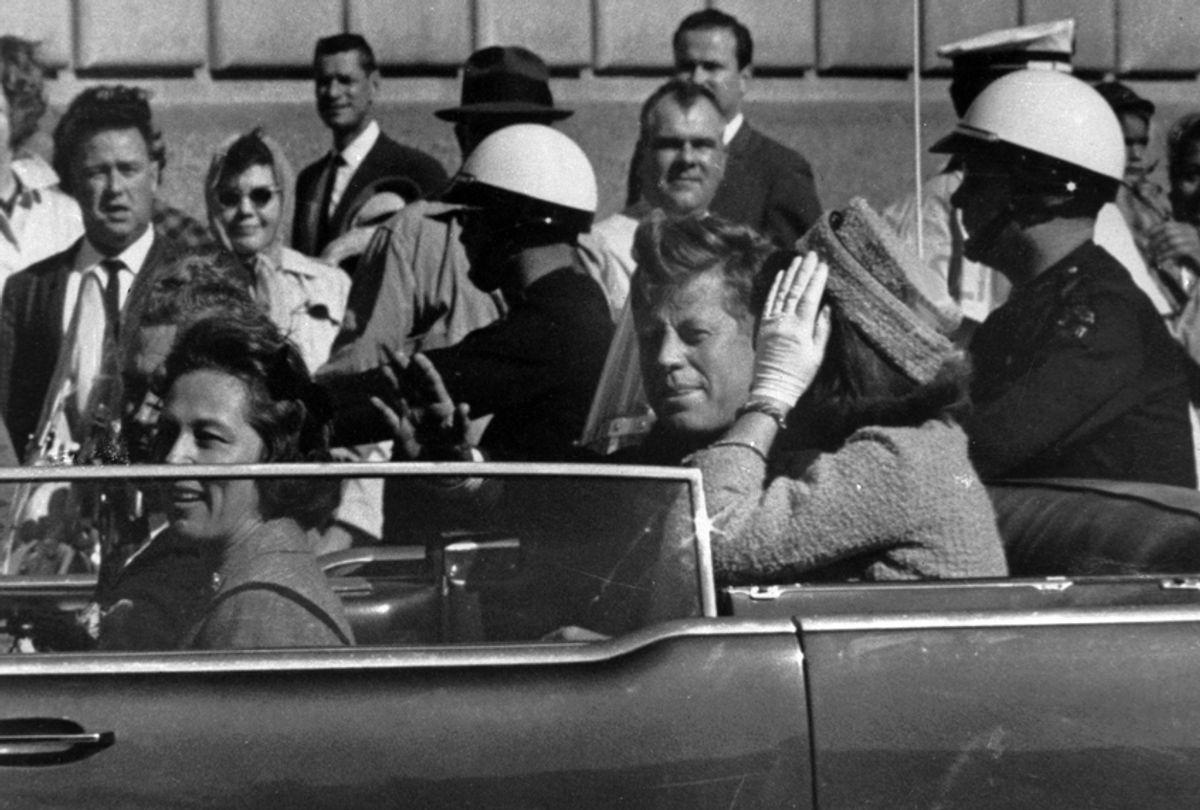 John F. Kennedy rides in the motorcade in Dallas, Texas., Nov. 22, 1963. (AP)