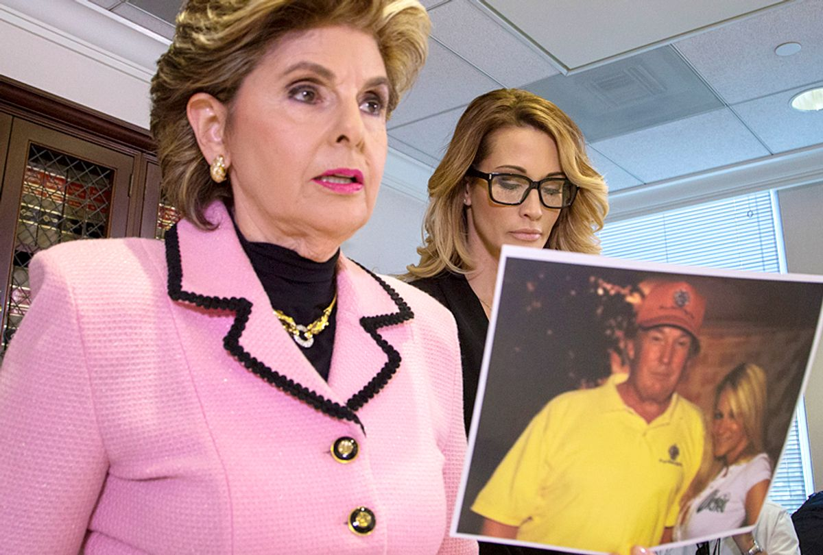 Attorney Gloria Allred holds a photo of jessica drake (R) with Donald Trump, taken in 2006 where Drake alleges Trump behaved in an sexually inappropriate way toward her. (Getty/David McNew)