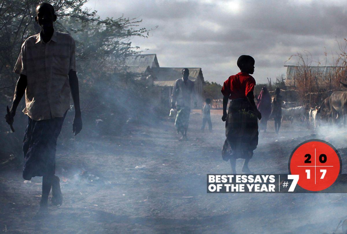 People walk through burning refuse in Dadaab, Kenya the world's biggest refugee complex August 20, 2009 in Dadaab, Kenya (Getty/Spencer Platt)