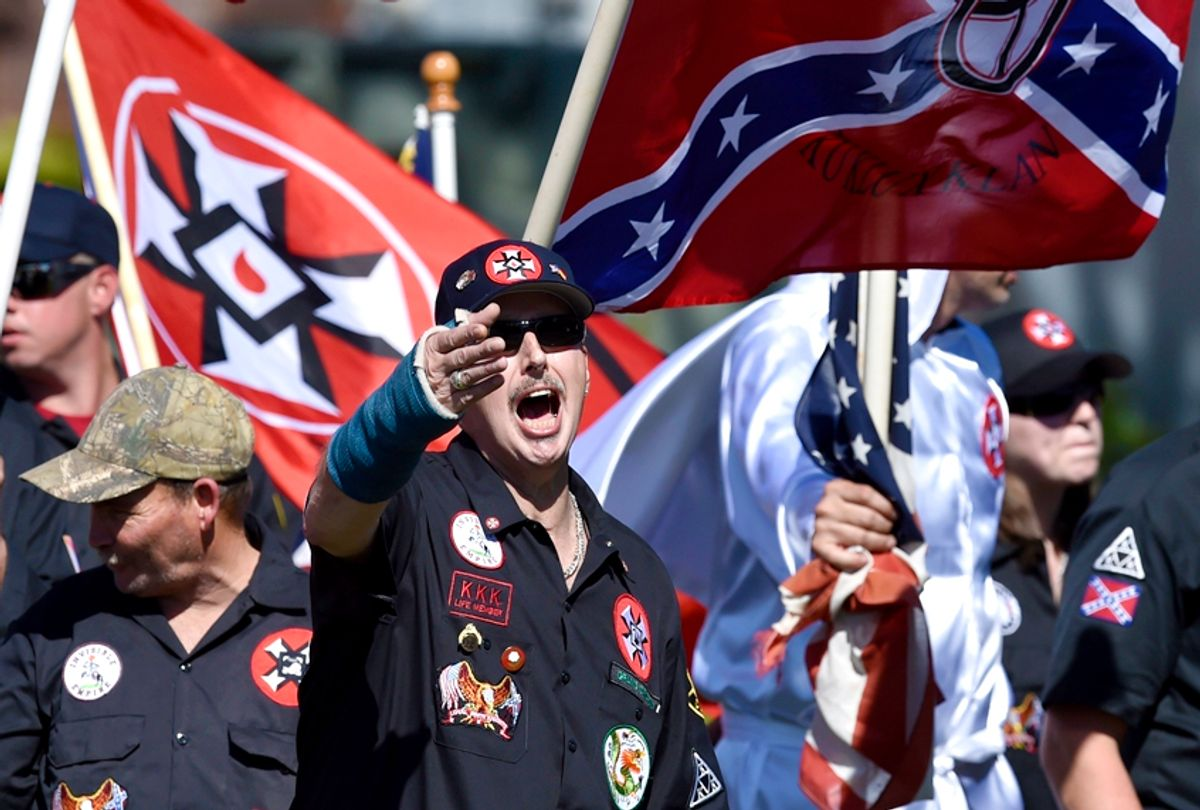 """Loyal White Knights Grand Dragon Will Quigg shouts to protestors during a """"White Pride"""" rally (AP/Mike Stewart)"""