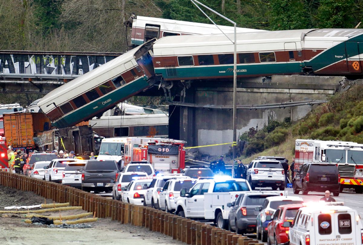 Cars from an Amtrak train lay spilled onto Interstate 5, in DuPont, Wash, Dec. 18, 2017. (AP/Elaine Thompson)