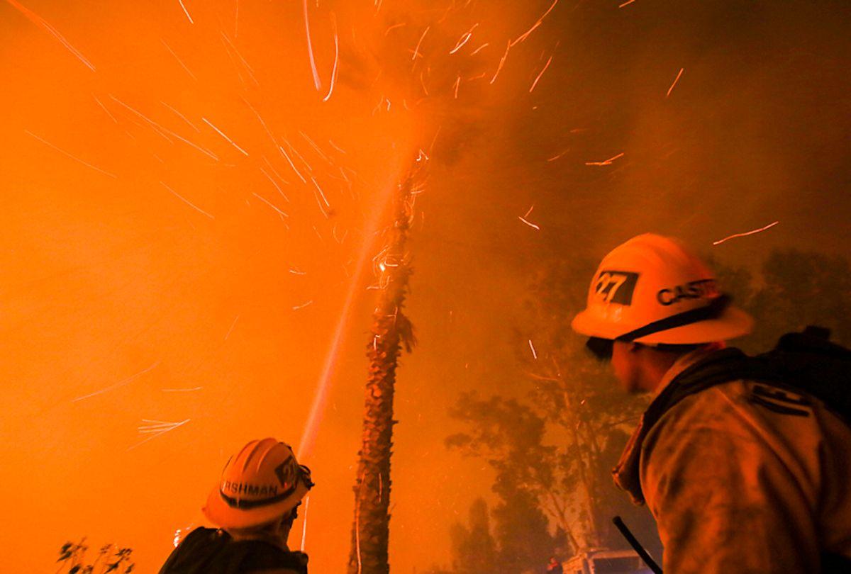Firefighters battle a wildfire in Santa Paula, California, December 5, 2017 (Getty/Ringo Chiu)