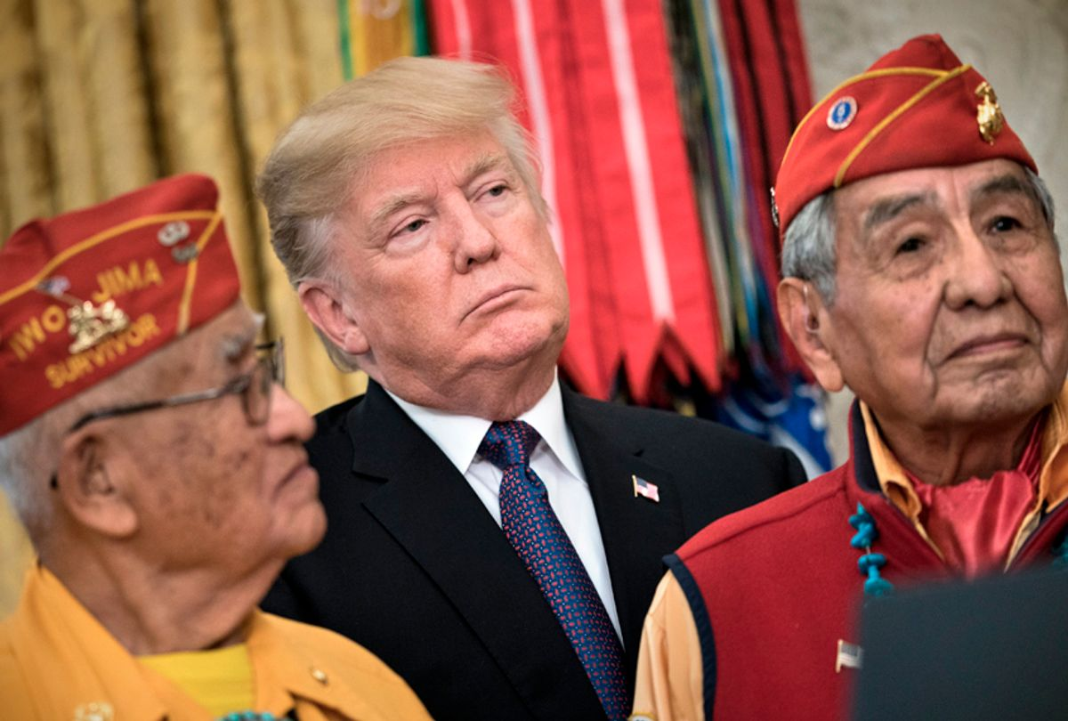 Donald Trump appears with Navajo Code Talkers in the White House during an event to honor Native American code talkers who served in World War II, November 27, 2017. (Getty/Brendan Smialowski)