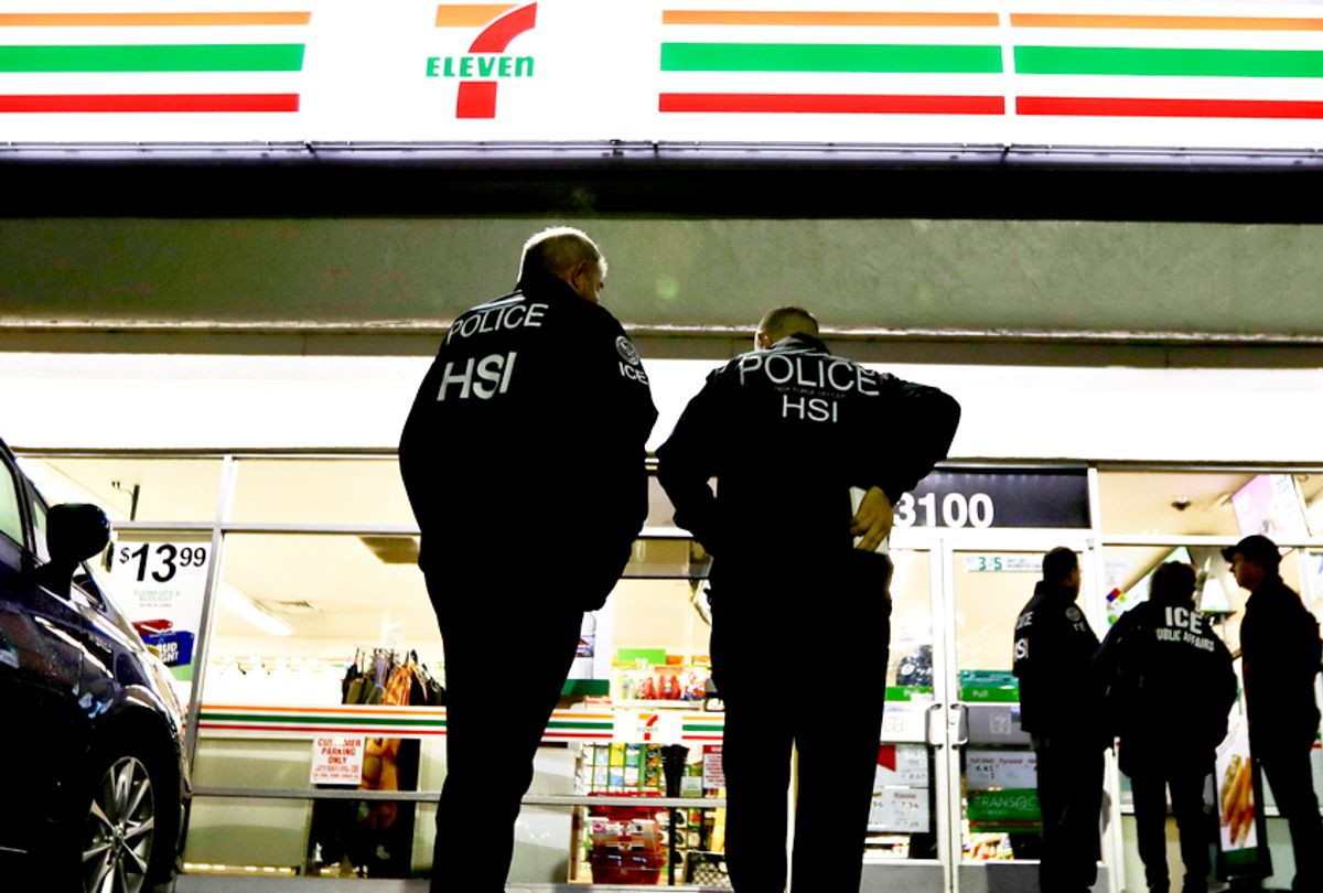 U.S. Immigration and Customs Enforcement agents serve an employment audit notice at a 7-Eleven store Jan. 10, 2018, in Los Angeles.  (AP/Chris Carlson)