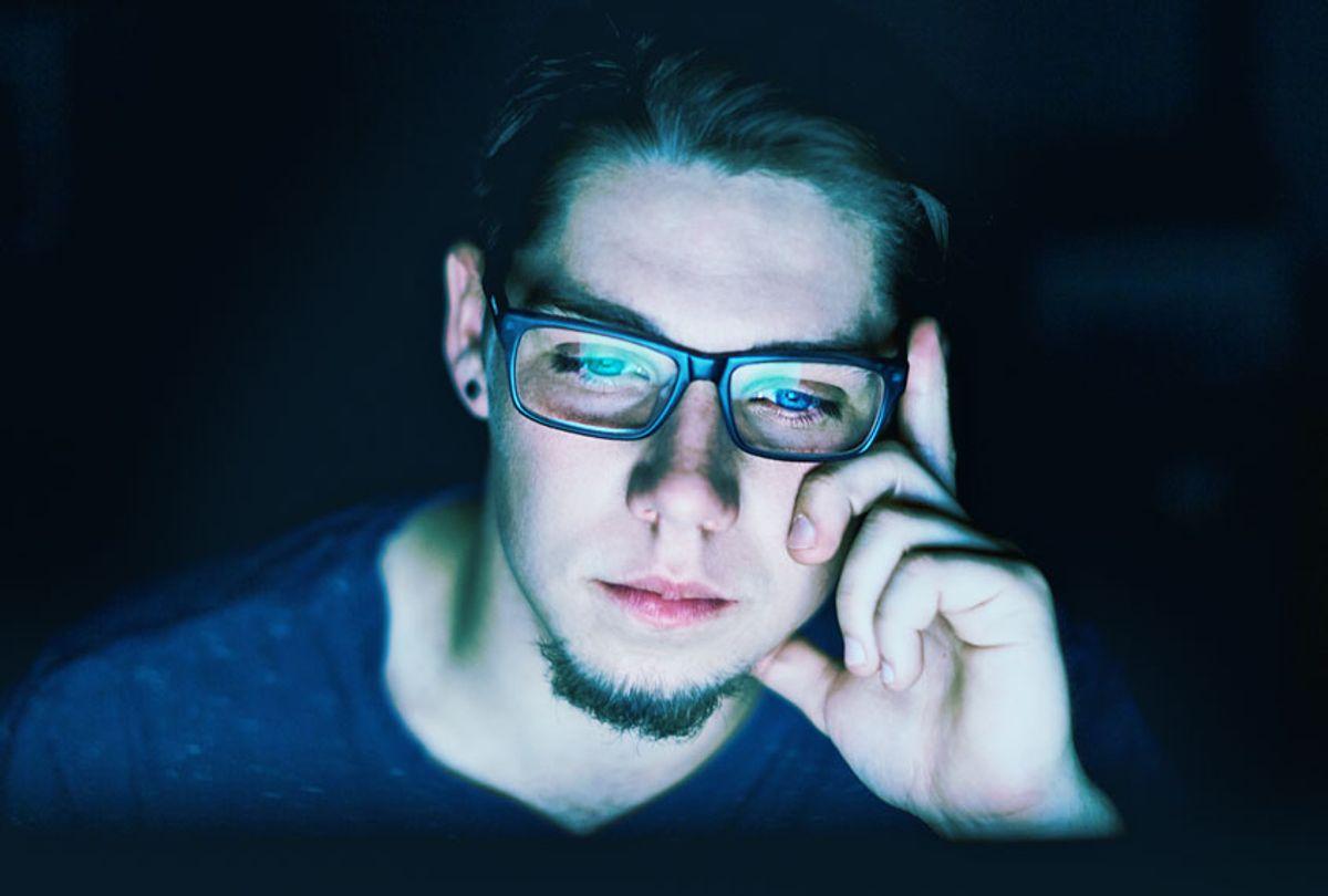 Man staring at computer screen (Getty Stock)