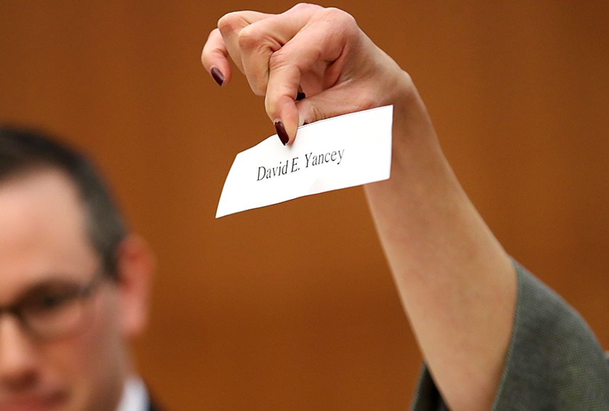 A slip of paper with the name of Virginia House of Delegates candidate David Yancey, the winner of a drawing to determine the winner of a tied election (Getty/Win McNamee)