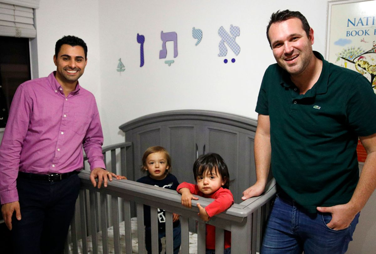 Elad Dvash-Banks, left, and his partner, Andrew, with their twin sons, Ethan, center right, and Aiden. (AP/Jae C. Hong)