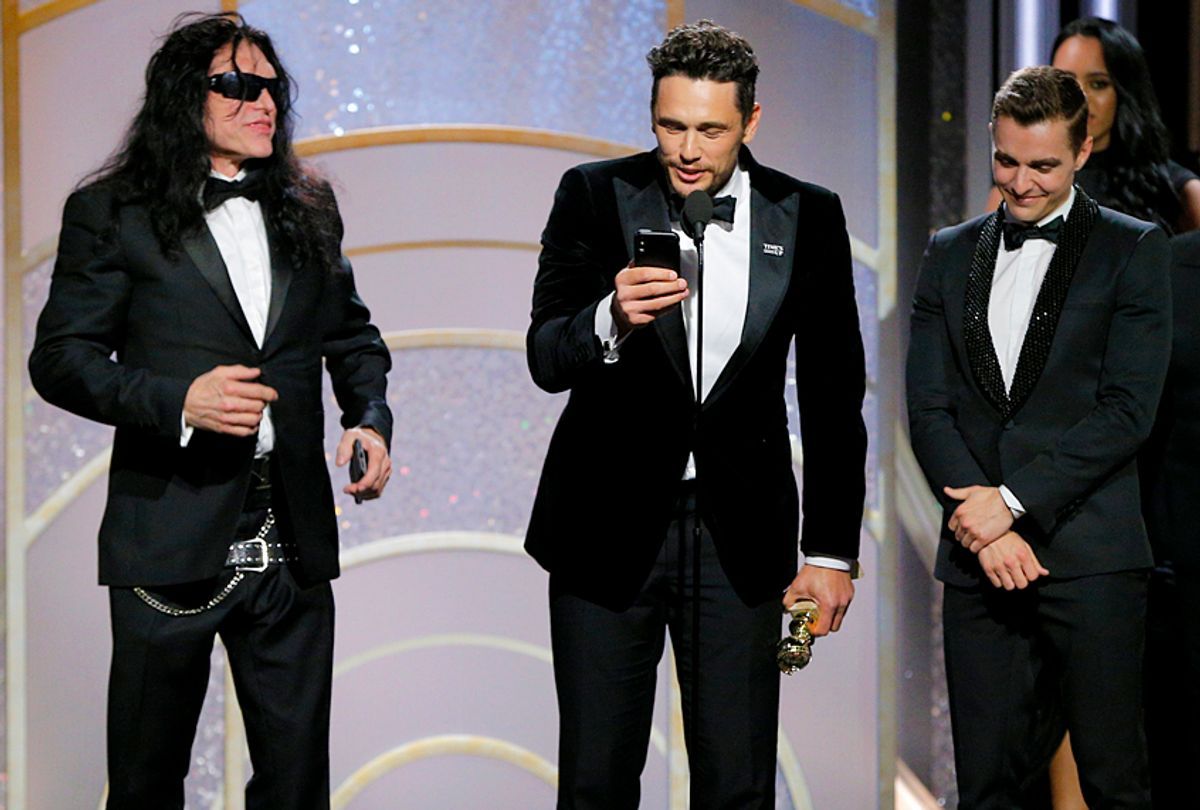 """James Franco, with Tommy Wiseau and Dave Franco,  accepts the award for Best Performance by an Actor in a Motion Picture – Musical or Comedy for  """"The Disaster Artist"""" during the 75th Annual Golden Globe Awards January 7, 2018 (Getty/Paul Drinkwater)"""