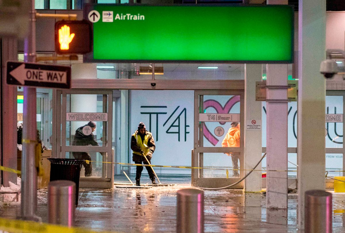 Workers sweep water from a floor of the arrivals area at John F. Kennedy International Airport's terminal 4 on January 7, 2018. (Getty/Jewel Samad)
