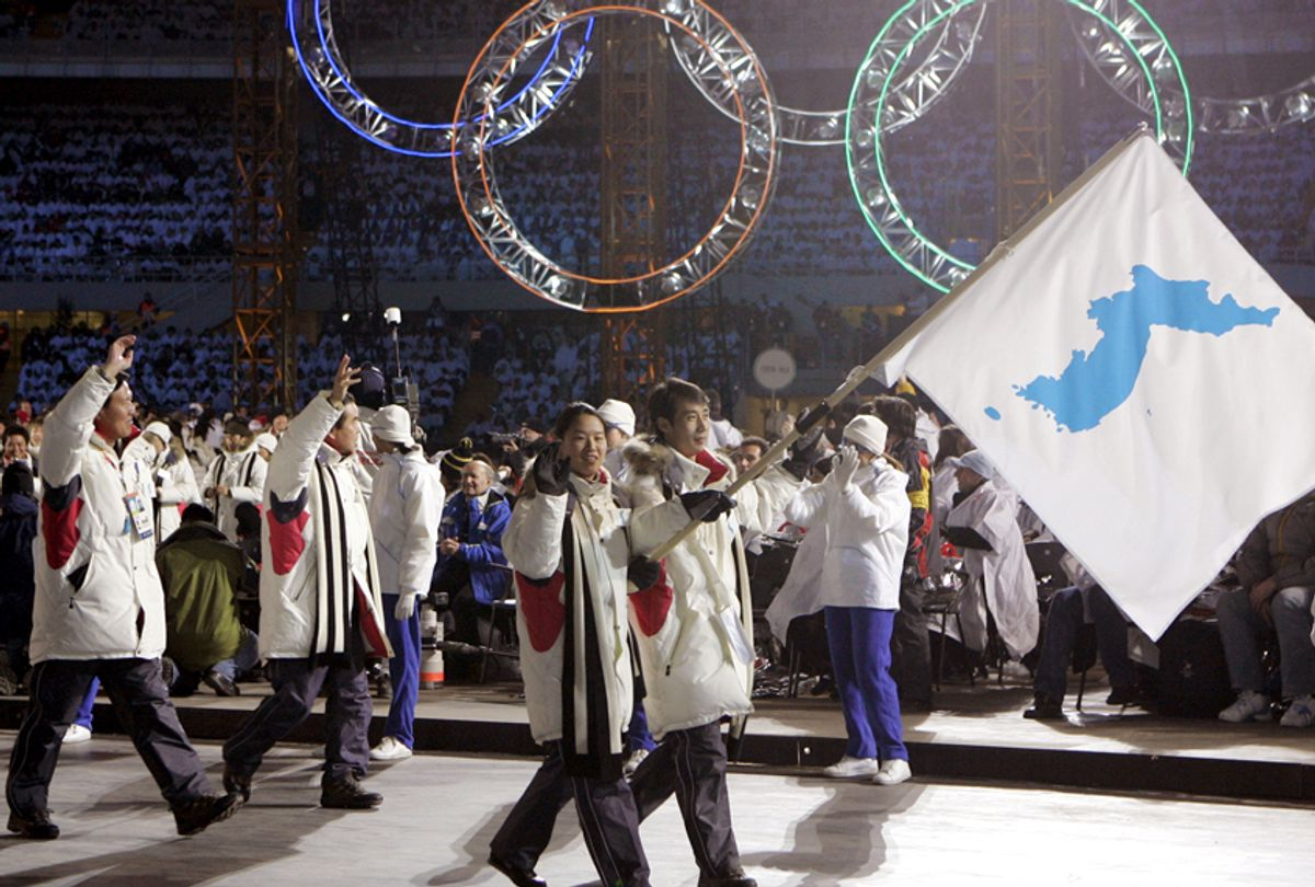 Korea flag-bearer's Bora Lee and Jong-In Lee, carrying a unification flag, lead their teams into the stadium during the 2006 Winter Olympics opening ceremony. (AP/Amy Sancetta)