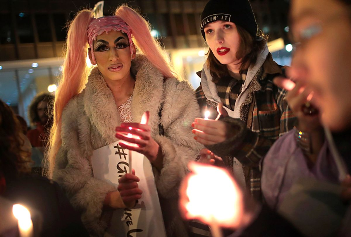 Demonstrators protest for transgender rights and hold a candlelight vigil to remember transgender friends lost to murder and suicide (Getty/Scott Olson)