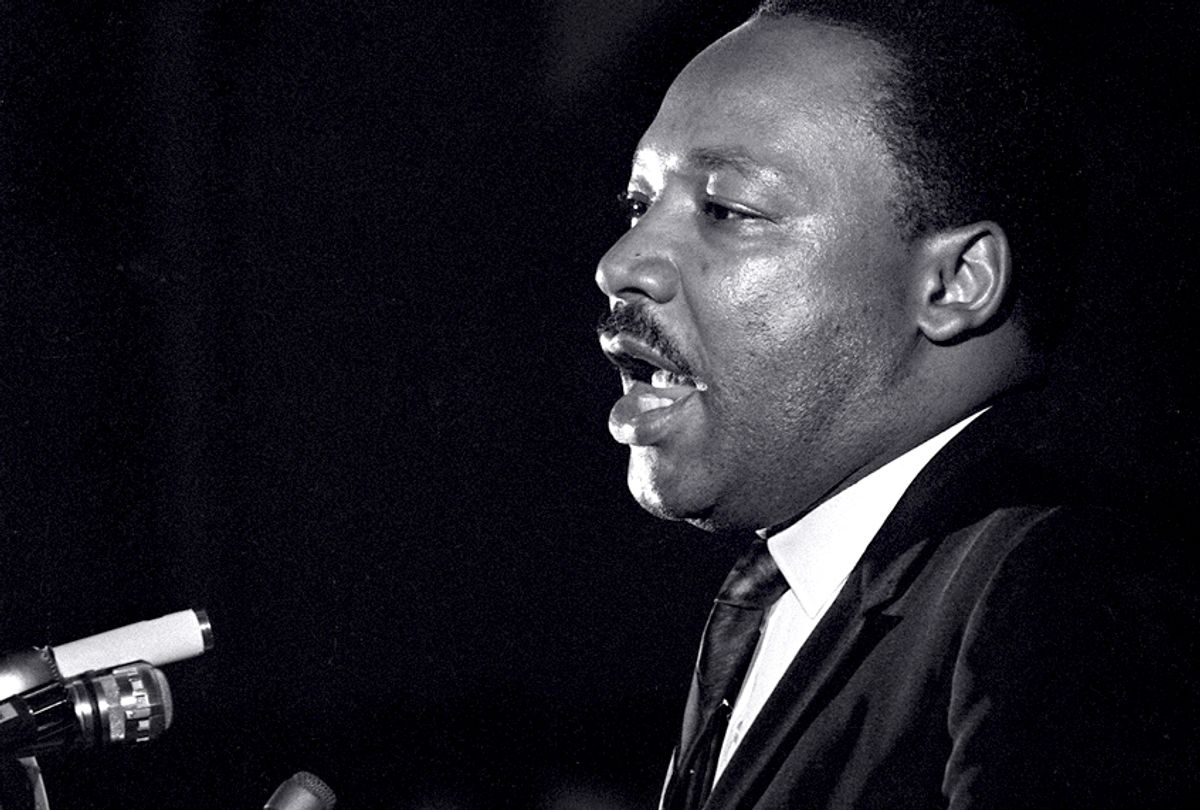 Dr. Martin Luther King Jr. makes his last public appearance at the Mason Temple in Memphis, Tenn., on April 3, 1968.  (AP/Charles Kelly)