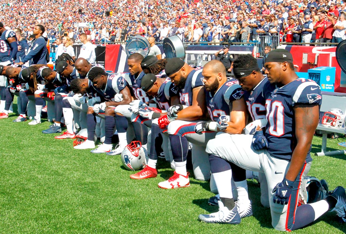 Members of the New England Patriots kneel during the National Anthem before a game (Getty/Jim Rogash)