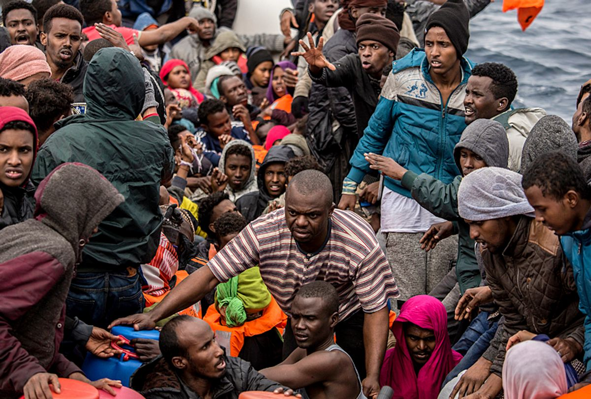 Refugees and migrants wait to be rescued by aid workers of the Spanish NGO Proactiva Open Arms, after leaving Libya trying to reach European soil aboard an overcrowded rubber boat, 60 miles north of Al-Khums, Libya. (AP/Olmo Calvo)