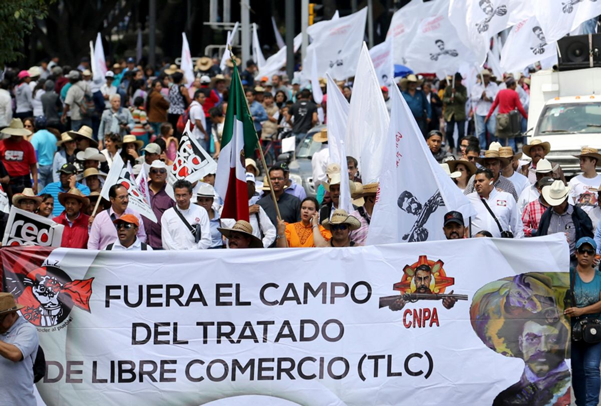 """Farmers march with a sign that reads """"Remove farming from NAFTA"""" in Mexico City. (AP/Gustavo Martinez Contreras)"""