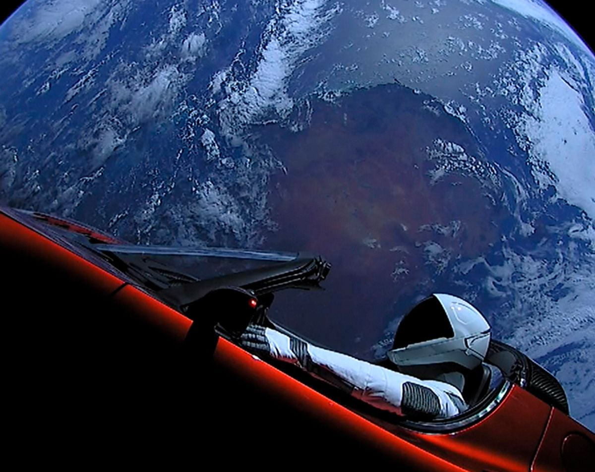 """A Tesla roadster launched from the Falcon Heavy rocket with a dummy driver named """"Starman""""  heads towards Mars. (Gett/SpaceX)"""