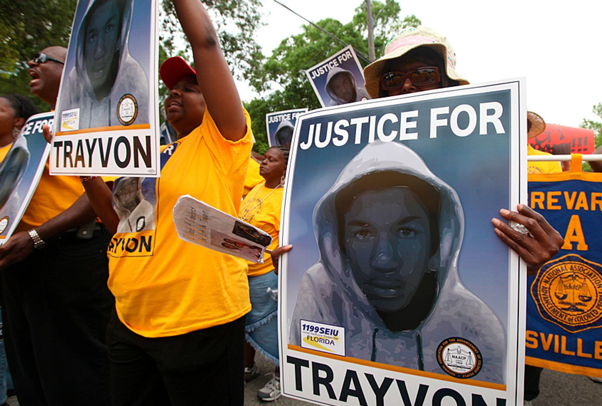 Protestors hold up signs in a march and rally for slain Florida teenager Trayvon Martin (AP/Julie Fletcher)