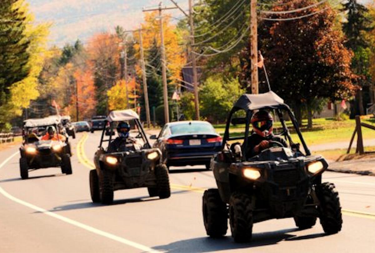 Polaris recreational off-highway vehicles riding on a highway in Gorham, N.H. (Christopher Jensen)