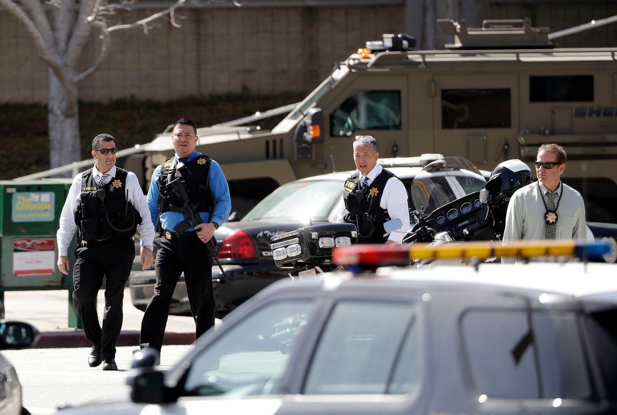 Armed law enforcement personnel exit YouTube headquarters, Tuesday, April 3, 2018, in San Bruno, Calif. (AP Photo/Marcio Jose Sanchez)
