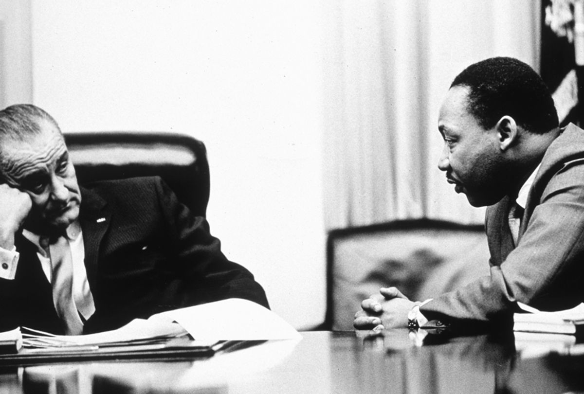 President Lyndon B Johnson discusses the Voting Rights Act with civil rights campaigner Martin Luther King Jr. (Getty/Hulton Archive)