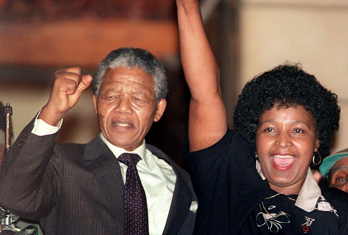 Nelson Mandela and Winnie Mandela cheering crowd upon Mandela's release from Victor Verster prison. (Getty/Walter Dhladhla)