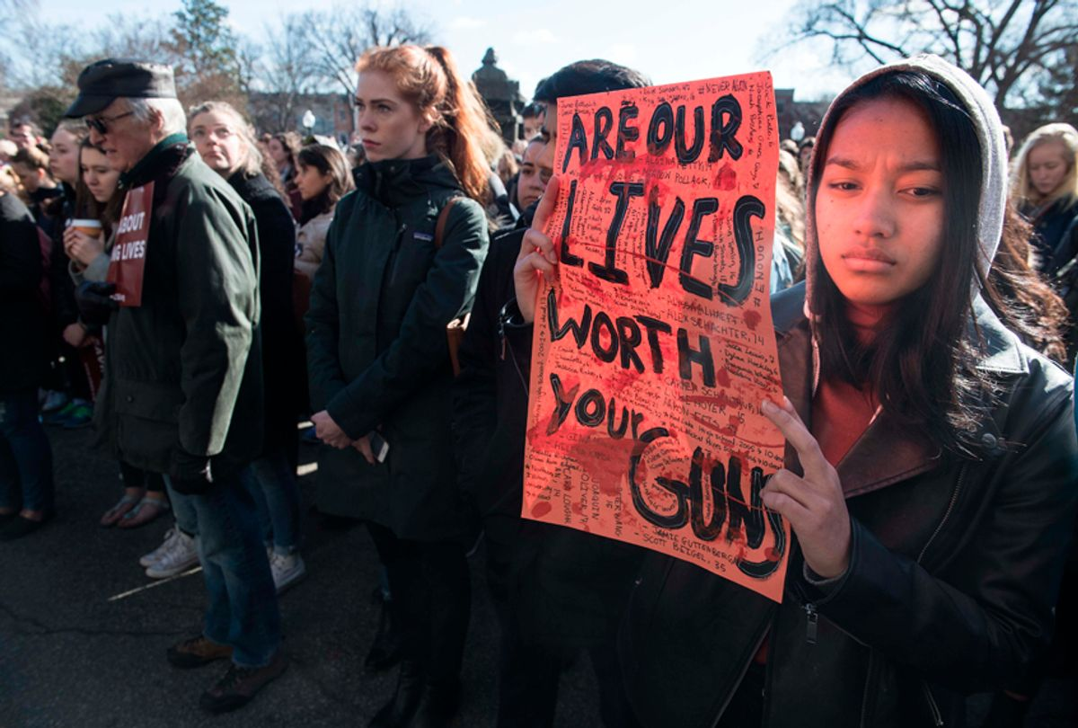 A student holds a sign at Georgetown University on March 14, 2018 during a national walkout to protest gun violence, one month after the school shooting in Parkland, Florida. (Getty Images)