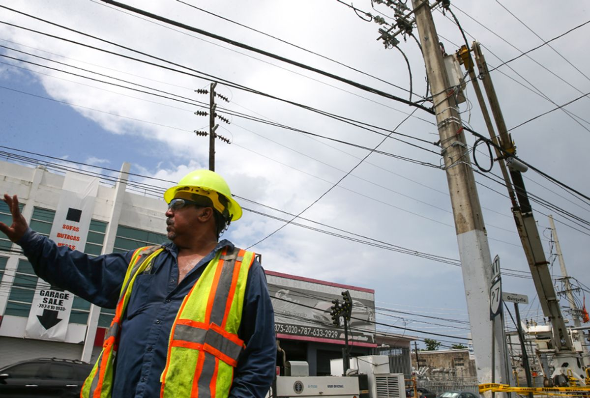 Repair work is done on power lines affected by Hurricane Maria April 18, 2018 in San Juan, Puerto Rico. (Getty Images)