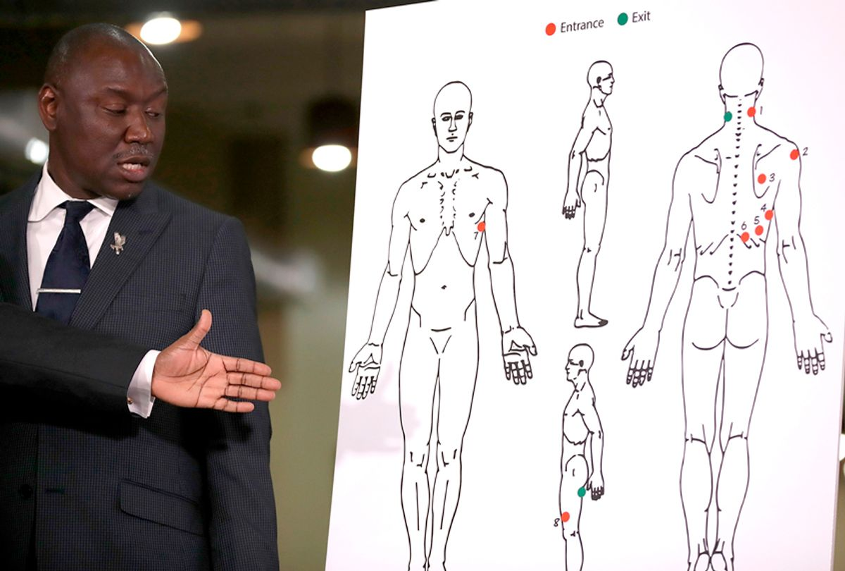 Attorney Ben Crump looks at a diagram showing gunshot wounds to Stephon Clark during a news conference at the Southside Christian Center on March 30, 2018 in Sacramento, California. (Getty/Justin Sullivan)