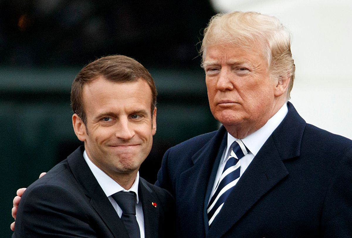 French President Emmanuel Macron hugs Donald Trump during a State Arrival Ceremony on the South Lawn of the White House, April 24, 2018. (AP/Evan Vucci)