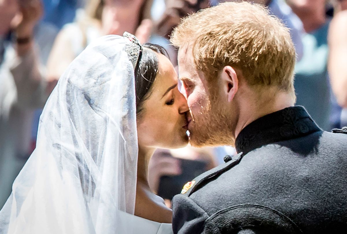 Meghan Markle and Prince Harry kiss on the steps of St George's Chapel at Windsor Castle following their wedding, Saturday, May 19, 2018. (AP/Danny Lawson)