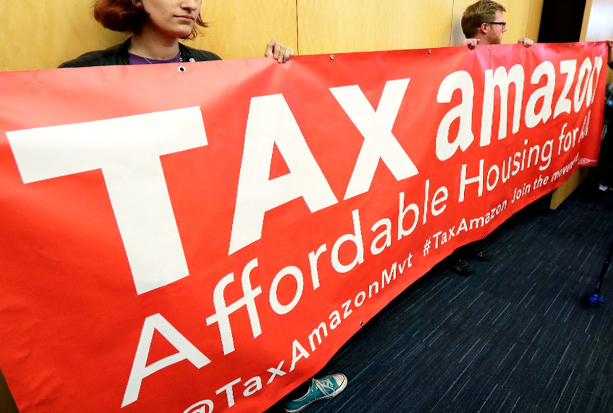 Demonstrators opposing the repeal of a tax on large companies such as Amazon and Starbucks in Seattle. (AP/Ted S. Warren)