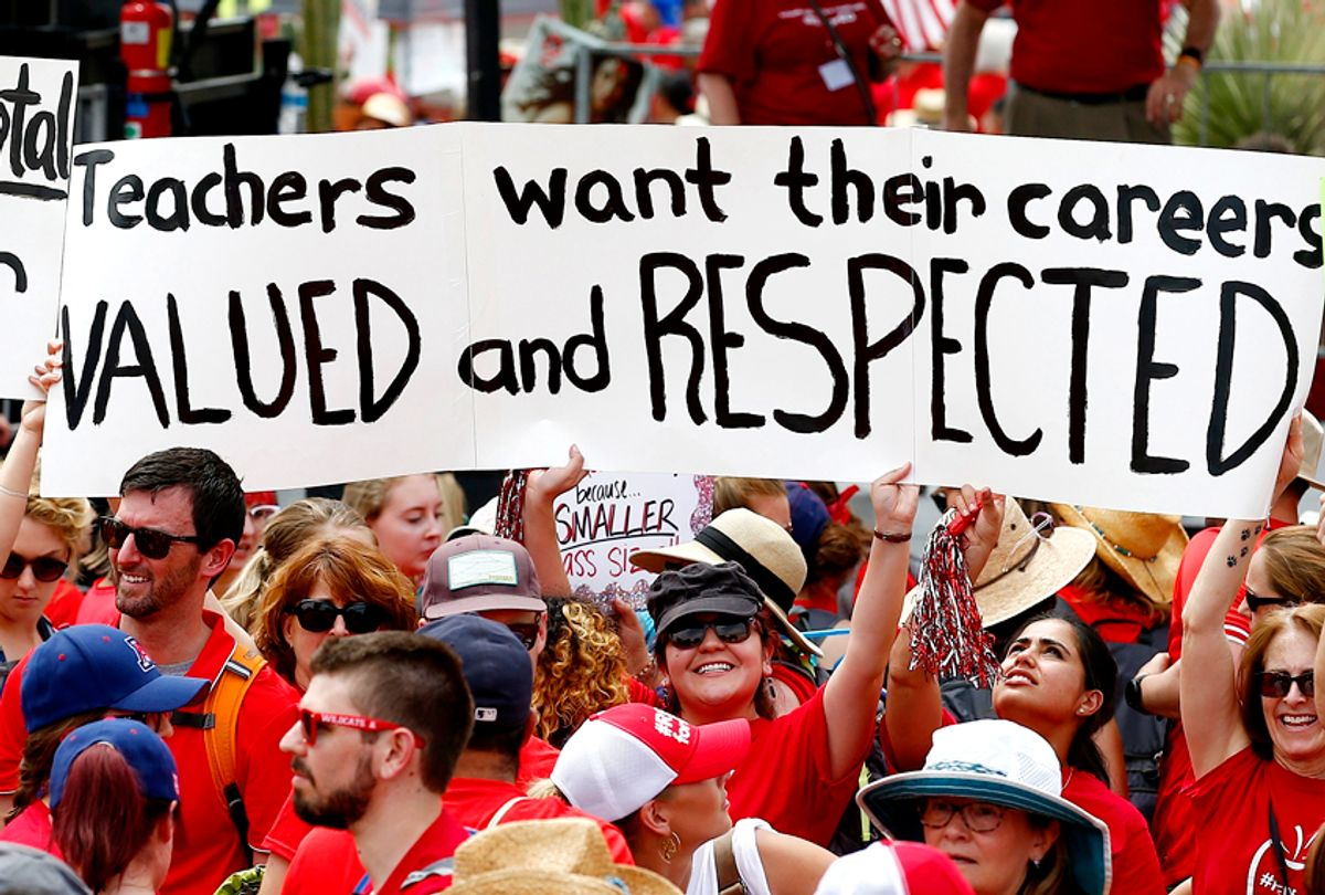 Thousands participate in a protest at the Arizona Capitol for higher teacher pay and school funding. (AP/Ross D. Franklin)