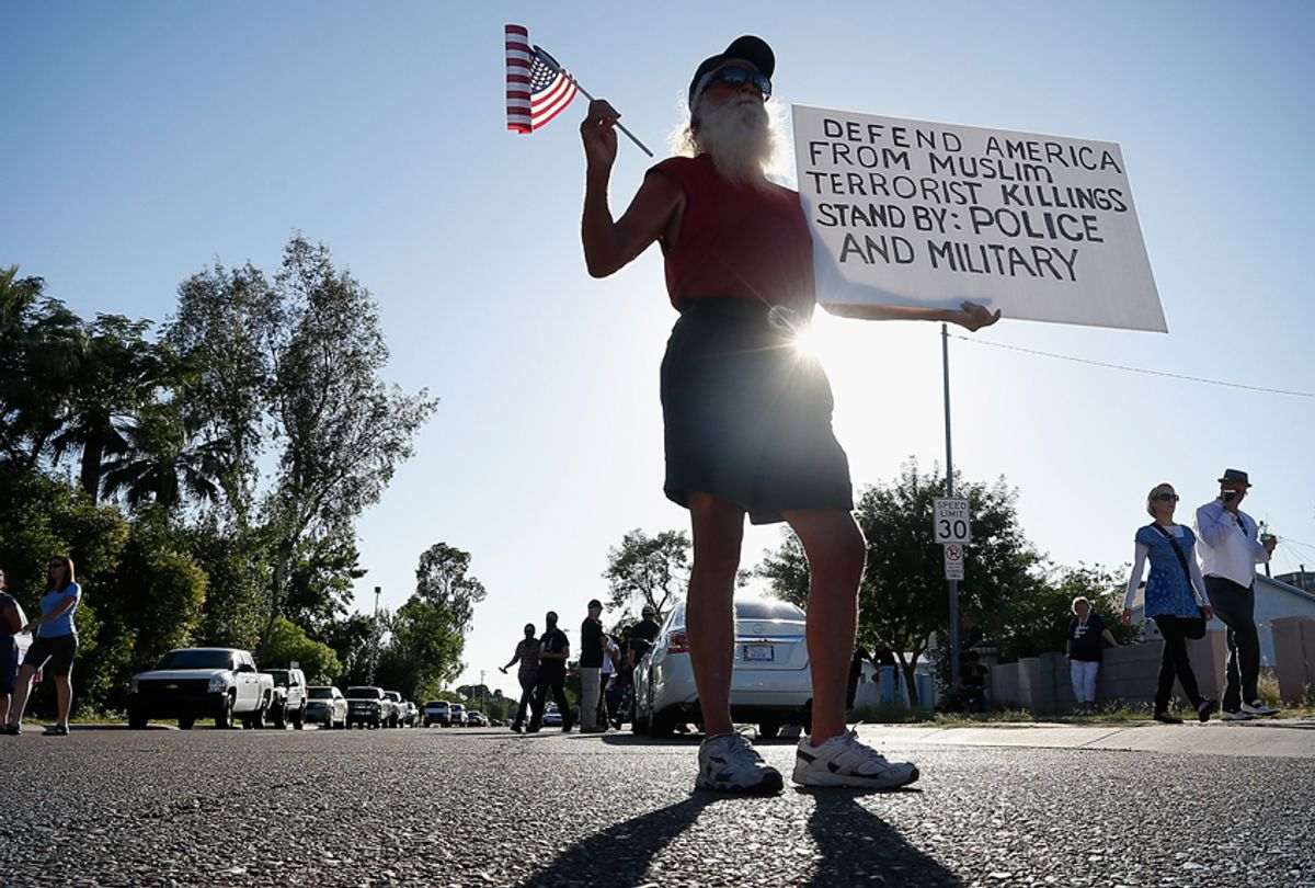 A protester outside the Islamic Community Center on May 29, 2015 in Phoenix, Arizona. (Getty/Christian Petersen)