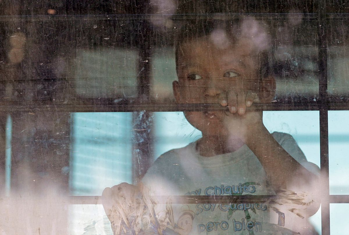 An immigrant child looks out from a U.S. Border Patrol bus, McAllen, Texas, June 23, 2018. (AP/David J. Phillip)