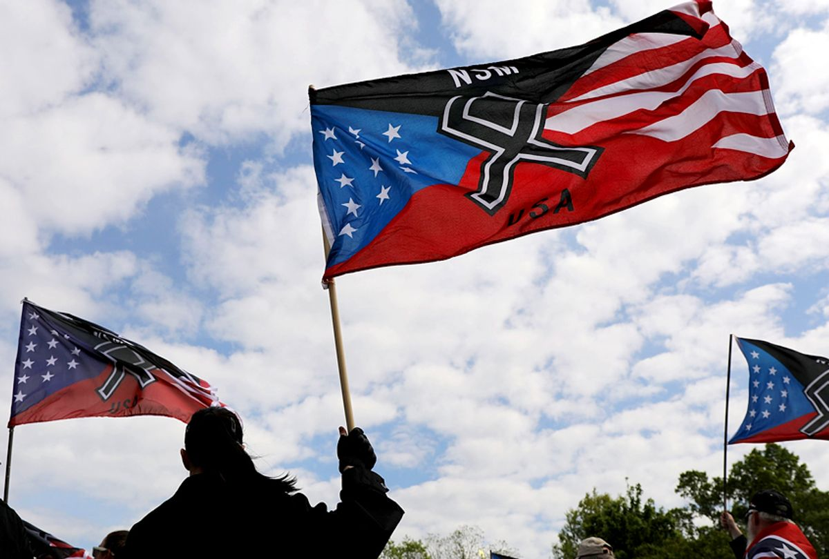 Members and supporters of the National Socialist Movement, one of the largest neo-Nazi groups in the US, hold a rally. (Getty/Spencer Platt)