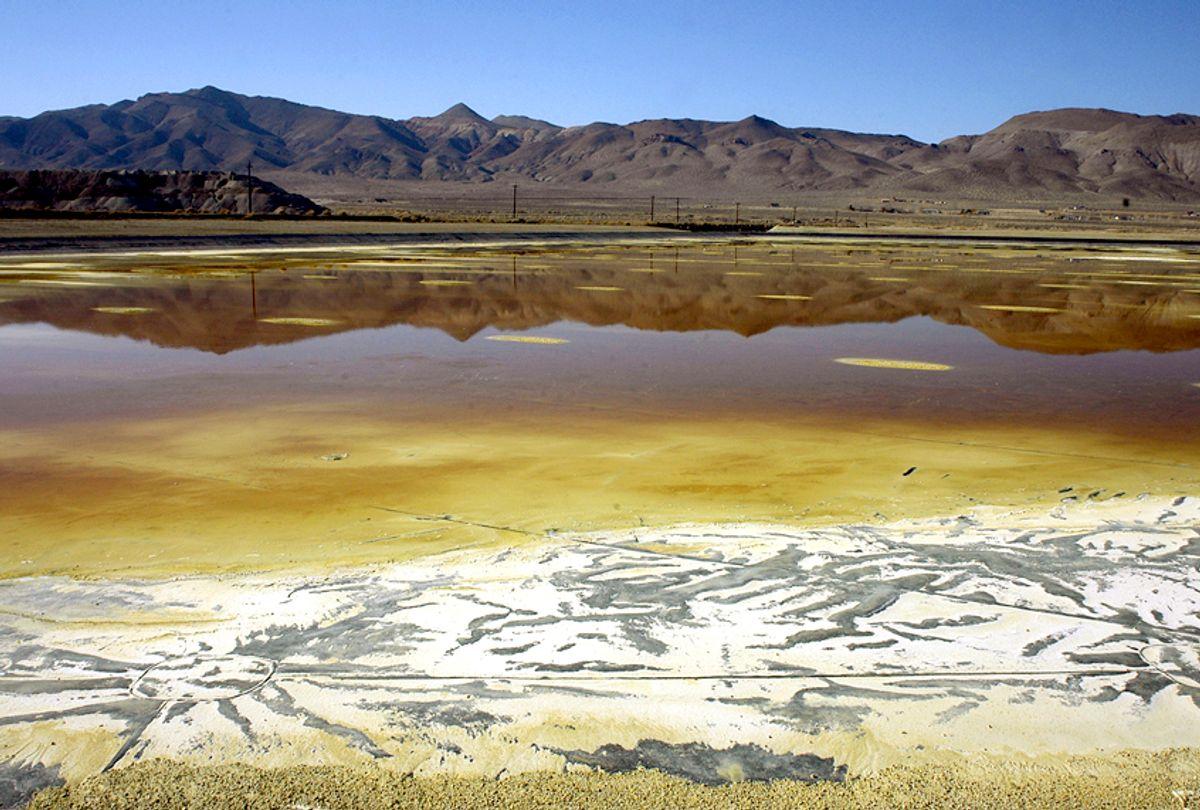 An evaporation pond holds contaminated fluid and sediment at the former Anaconda copper mine near Yerington, Nev. (AP/Debra Reid)