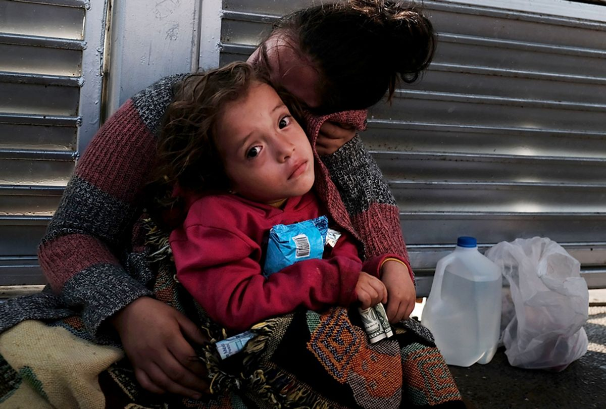 A Honduran child and her mother, fleeing poverty and violence in their home country, wait along the border bridge after being denied entry from Mexico into the U.S. (Getty/Spencer Platt)