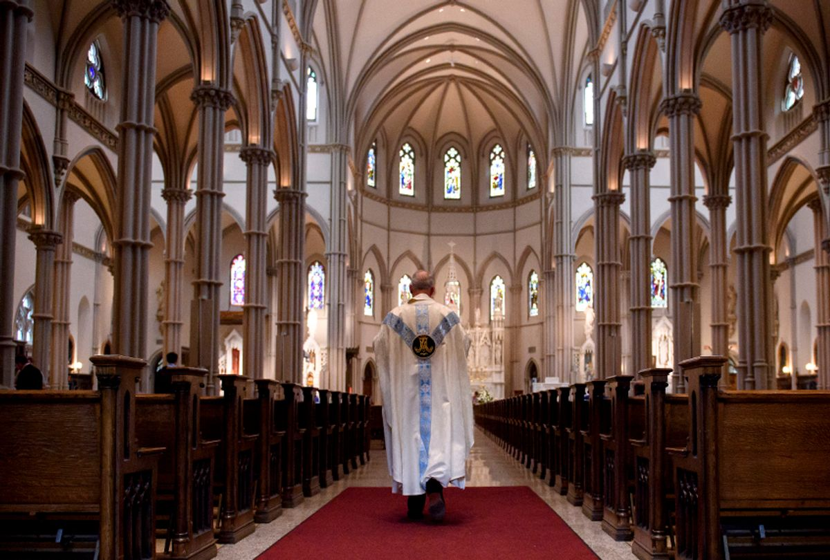 Father Kris Stubna walks to the sanctuary following a mass to celebrate the Assumption of the Blessed Virgin Mary at St Paul Cathedral, the mother church of the Pittsburgh Diocese on August 15, 2018 in Pittsburgh. (Getty/Jeff Swensen)