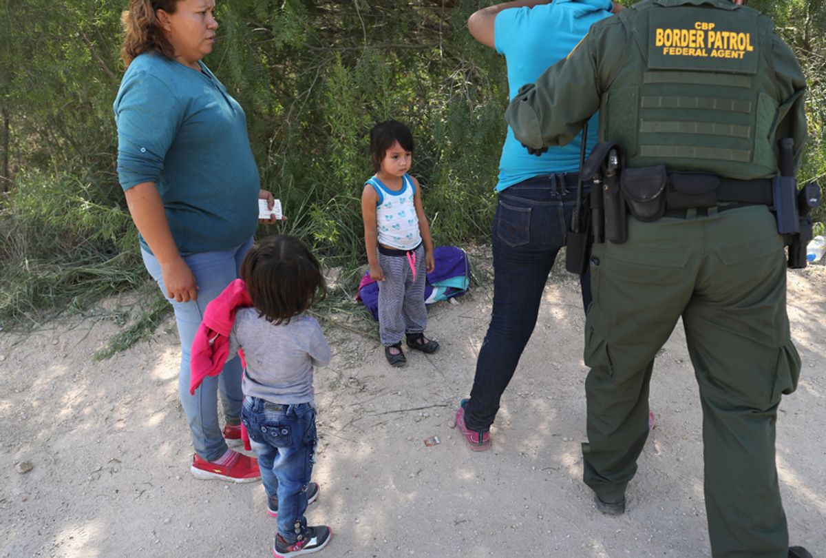 U.S. Border Patrol agents take Central American asylum seekers into custody on June 12, 2018 near McAllen, Texas. The immigrant families were then sent to a U.S. Customs and Border Protection (CBP) processing center for possible separation. (Getty/John Moore)