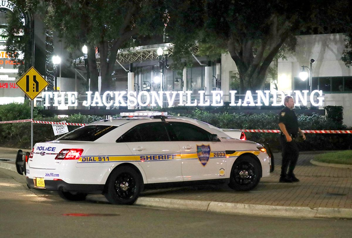 A Jacksonville Sheriff officer helps keep the perimeter secure as law enforcement investigates a shooting at the GLHF Game Bar at the Jacksonville Landing on August 27, 2018 in Jacksonville, Florida. (Getty/Joe Raedle)