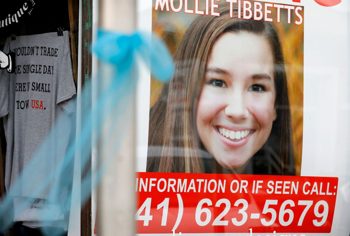 A poster for missing University of Iowa student Mollie Tibbetts hangs in the window of a local business, Aug. 21, 2018, in Brooklyn, Iowa. (AP/Charlie Neibergall)
