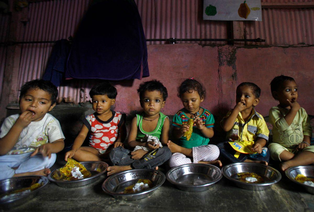 Malnourished children eat a meal at the Apanalaya Center in Mumbai, India, Oct. 9, 2012. (AP/Rafiq Maqbool)
