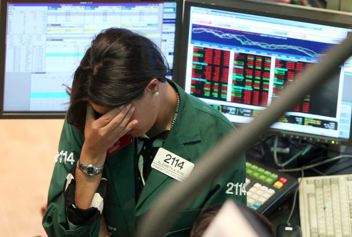 Elizabeth Rose, a specialist with Lehman Brothers MarketMakers, works her post on the trading floor of the New York Stock Exchange, Monday, Sept. 15, 2008. (AP/David Karp)