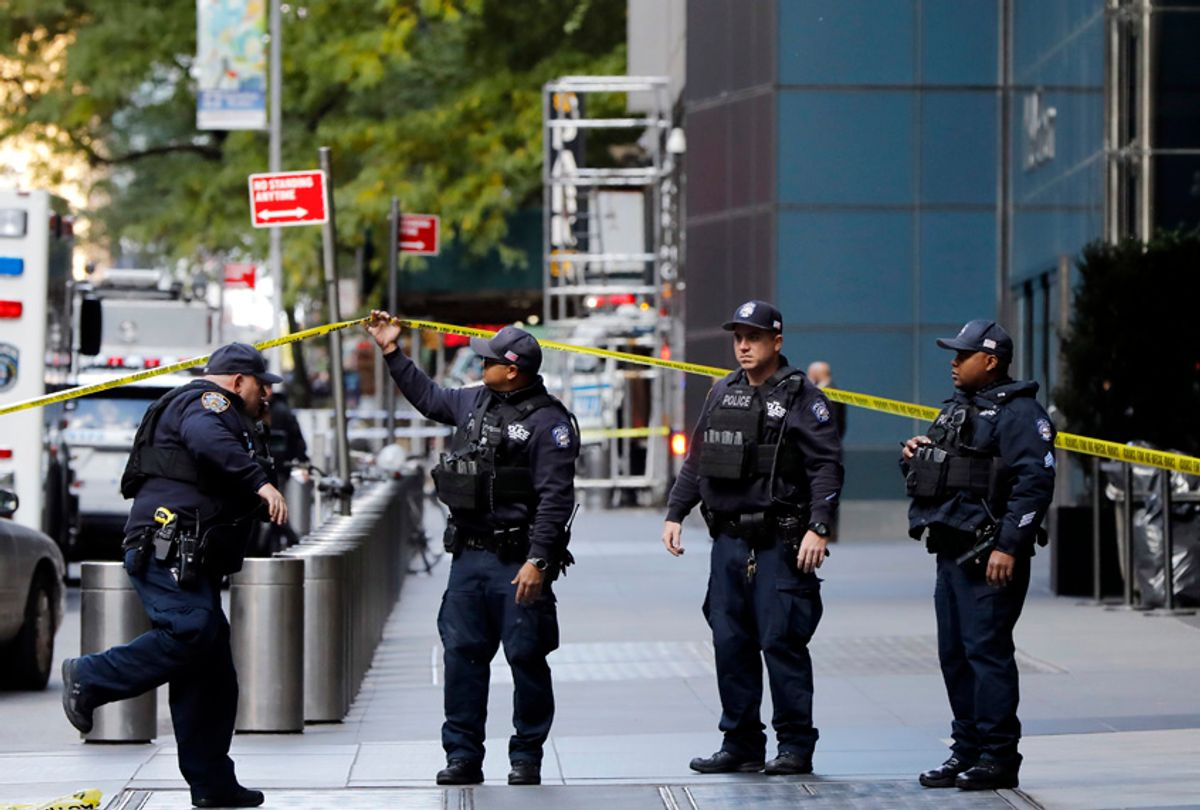 New York City Police Dept. officers arrive outside the Time Warner Center, in New York, Wednesday, Oct. 24, 2018. A police bomb squad was sent to CNN's offices in New York City and the newsroom was evacuated because of a suspicious package. (AP/Richard Drew)